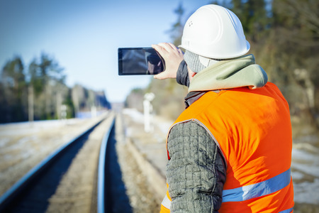 Railway engineer filmed on the railway Stock Photo