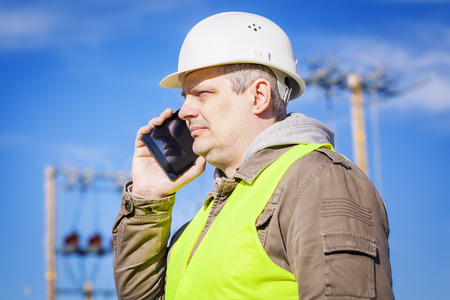 electrical engineer: Electrical engineer talking on cell phone at outdoors