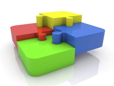 piezas de rompecabezas: Cuatro piezas de un rompecabezas en varios colores en blanco Foto de archivo