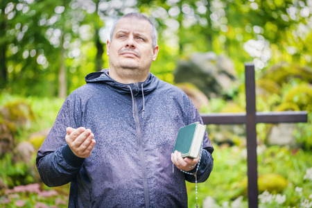 personal god: Preacher with Bible at outdoors Stock Photo
