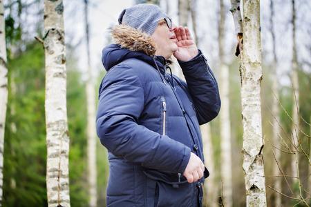man yelling: Man yelling in woods
