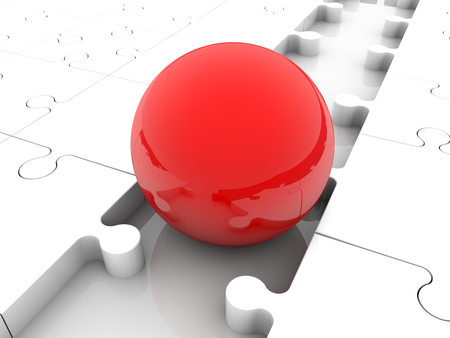 red ball: Red ball between puzzle pieces