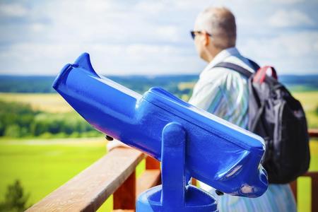 Watch tower binocular,viewer in blue photo
