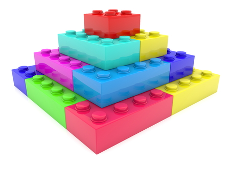 Colorful pyramid of toy bricks Stock Photo