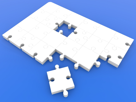 Top view on unfinished puzzle in white on blue