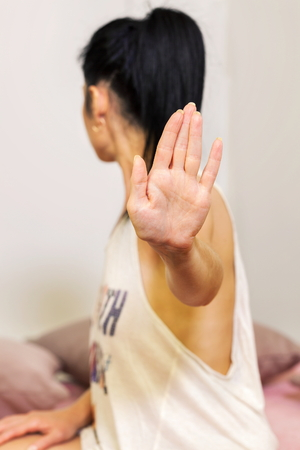 Woman showing stop gesture