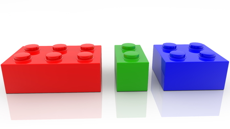 Three colorful toy bricks in various sizes Archivio Fotografico - 122712827