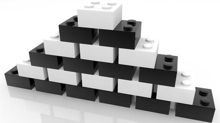 Pyramid of toy bricks in white and black colors on white Archivio Fotografico - 122712833