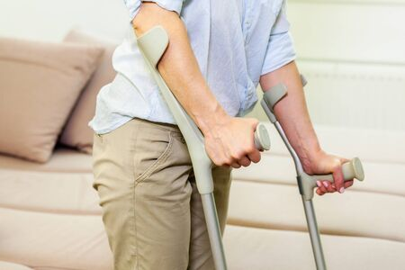 Injured woman on crutches stock photo