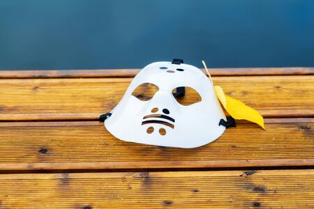Halloween hockey mask on Boat dock at the lake