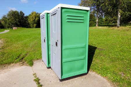 Public toilet outside in park in summer Stockfoto