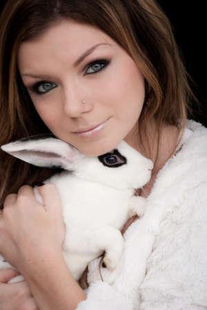 british girl: Beautiful British Girl Hold Rabbit  Stock Photo