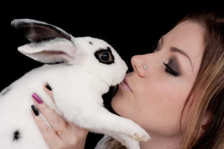 Beautiful Girl Kissing Rabbit