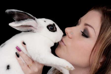 Beautiful Girl Kissing Rabbit