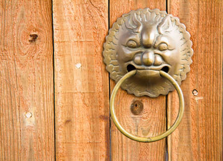 Chinese Door With Dragon Handle Head photo