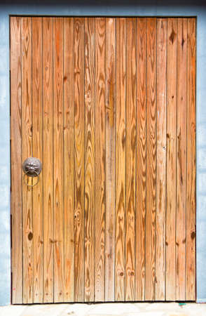 Big Wooden Door And Frame With Dragon Handle photo