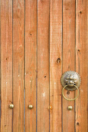 Close Up Wooden Door With Dragon Handle photo