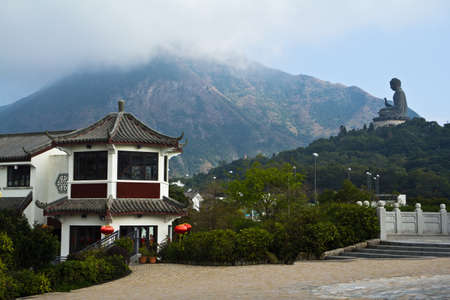 Chinese Temple With Big buddha Statue And Mountain View photo
