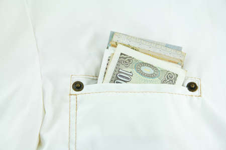 Money Inside Front Pocket Of White Jacket photo