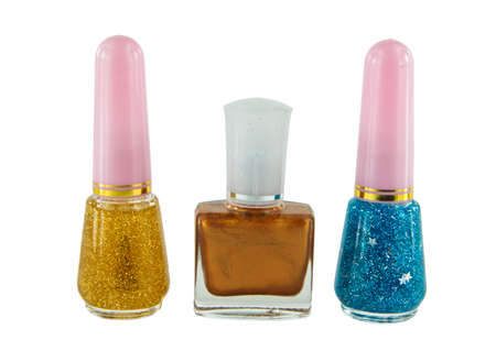 3 Bottles Of Different Color Nail Polish With White Background photo