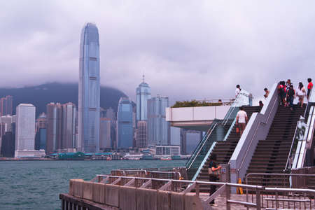 HONG KONG - June 24 : Many Tourists  Walk Up To Viewpoint To Enjoy The View Of Victoria Bay On June 24 Of 2012 In Hong Kong Famous Tourist Destination.