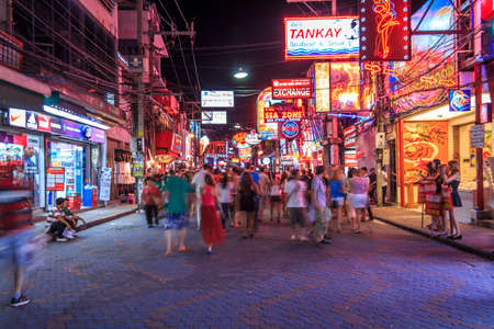 PATTAYA - Jul 29 2012 Crowds Of Tourist Pedestrians At Night Life Location With Colorful Advertising Signs And Neon Lights Surrounding The Street At Busy