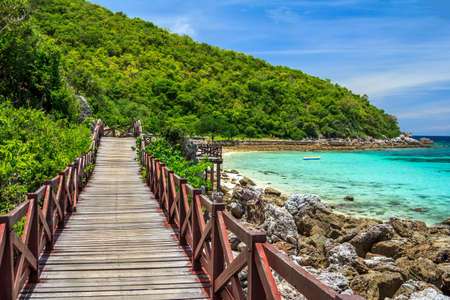 Amazing Island Paradise Beach With Wooden Bridge Alongside