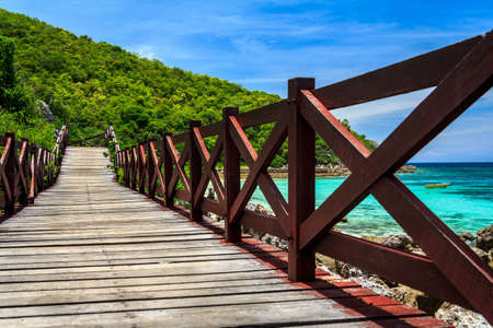 next horizon: Amazing Island Paradise Beach With Wooden Bridge Alongside