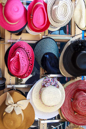 Colorful Hats Store Hanging On Display photo