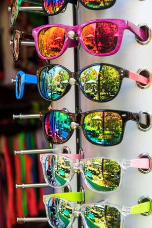 Fashion Sunglasses Store Hanging On Display photo