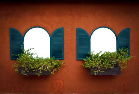 Open Window With Flower Basket On Orange Wall photo