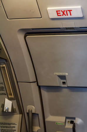 Emergency Exit Door In The Aircraft Stock Photo