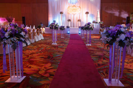 red carpet background: Luxury Indoors Red Carpet With Stage Wedding Party