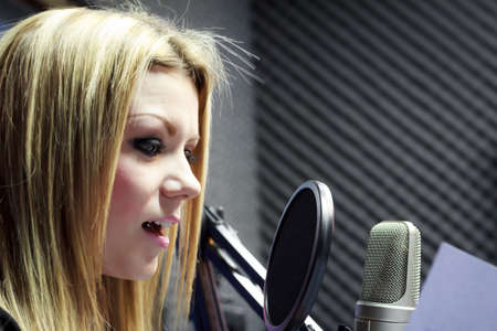 Beautiful Woman Working As Radio DJ Live In Studio photo