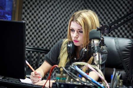 radio dj: Woman Working As Radio DJ Live In Studio Stock Photo