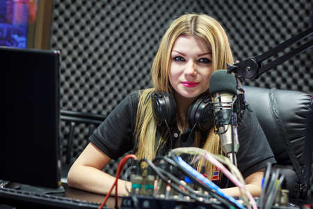 work station: Woman Working As Radio DJ Live In Studio Stock Photo