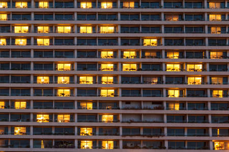 Condo Windows At Night Background photo