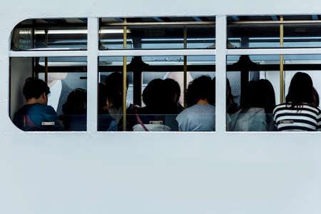 Passengers In Tram At Hong Kong City photo