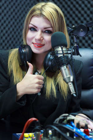 Beautiful Woman Thumbs Up While Recording Sound In Media Studio photo
