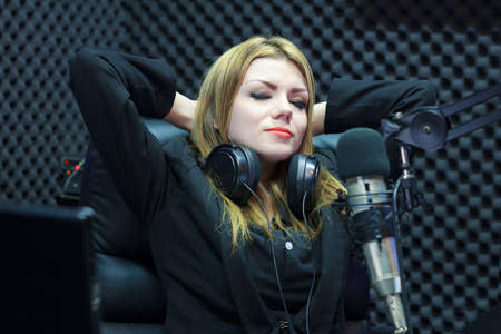 Happy Success Beautiful DJ Woman Resting While Working In Recording Studio Room