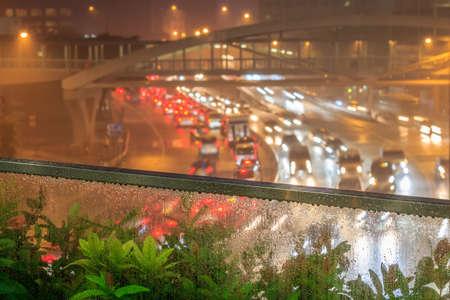 Defocused Of Street Lights At Night While Raining photo
