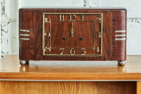 winder: Antique Winder Table Clock On Brick Background