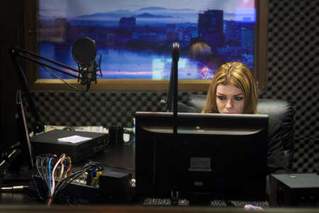 Woman Working As Radio DJ Live In Studio