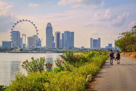 city park skyline: Tourist Walking On The Way For Sightseeing In Singapore City