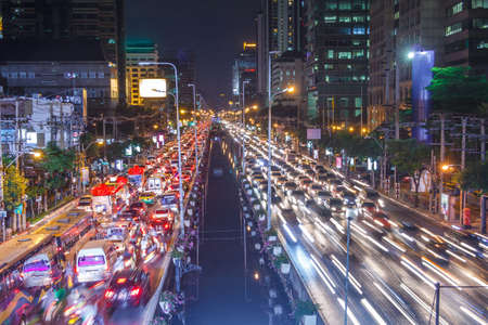 Crowded Traffic Jam In Capital City, Urban Nigh In Bangkok City, Thailand. photo