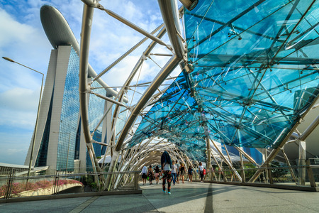 marina life: SINGAPORE - MARCH 29: The Helix Bridge on MARCH 29, 2015 in Singapore, is a pedestrian bridge linking Marina Centre with Marina South in the Marina Bay area in Singapore.