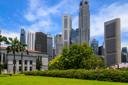sylvan: Singapore Park With Tall Buildings Stock Photo