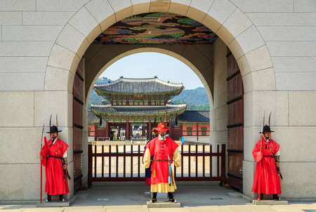 Seoul, South Korea - JUNE 10: Guards at Gwanghwamun Gate, the entrance of Gyeongbokgung Palace on June 10, 2015 in Seoul of South Korea, Guards have been placed at the palace, since the 14th C.