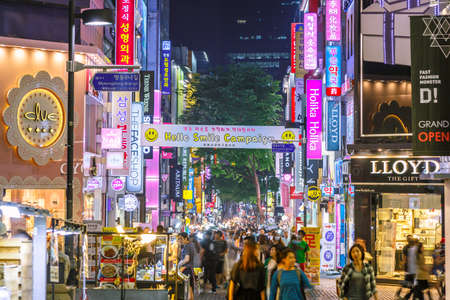 Seoul: Seoul, South Korea - June 09, 2015: Crowds tourist at the Myeong-Dong street night market with neon lights shop signs. The location is the premiere district for shopping in Seoul city.
