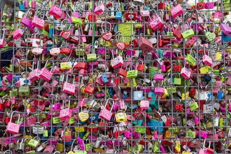 lock: Seoul, South Korea - June 09, 2015: Padlock at N Seoul Tower, at Seoul tower. People believe that the locked key will keep their forever love. Editorial